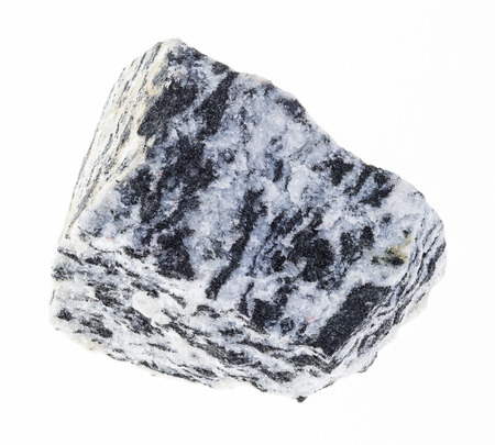 macro photography of natural mineral from geological collection - rough migmatite gneiss stone on white background