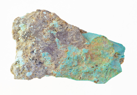 macro photography of natural mineral from geological collection - piece of rough turquoise stone on white background