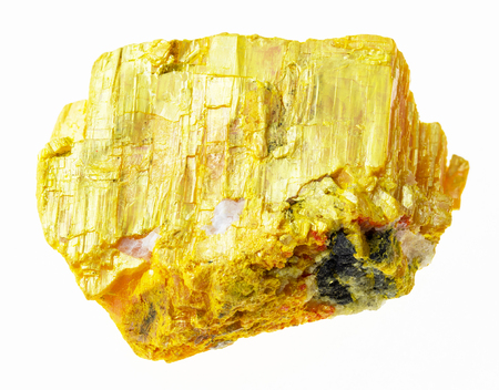 macro photography of natural mineral from geological collection - raw orpiment stone on white background Stock Photo