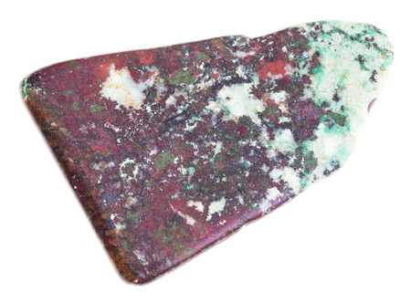 macro photography of natural mineral from geological collection - red cuprite and green chrysocolla in polished slab on white background