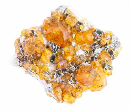 macro photography of natural mineral from geological collection - raw yellow garnet spessartine crystals on white background Stock Photo
