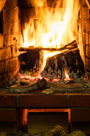 front view of burning firewood in oven in rural house