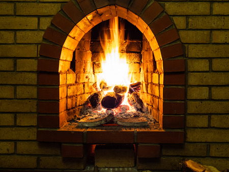 front view of burning firewood in fireplace in rural house 版權商用圖片