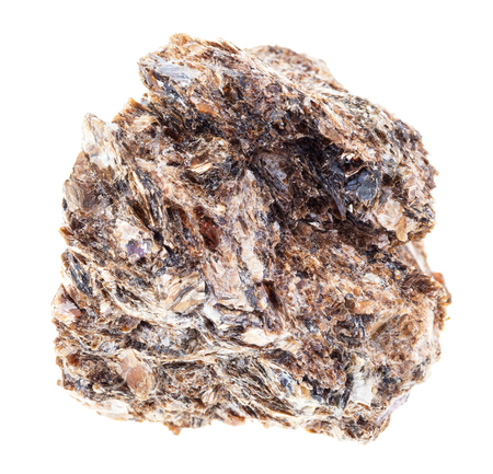 macro photography of natural mineral from geological collection - rough Phlogopite (magnesium Mica) stone on white background