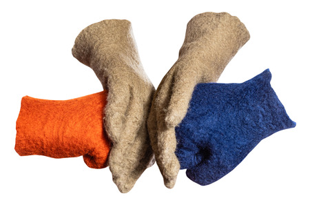 green gloves split the fists from orange and blue gloves isolated on whie background
