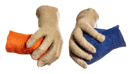 green gloves divide the fists from orange and blue gloves isolated on whie background Stock Photo