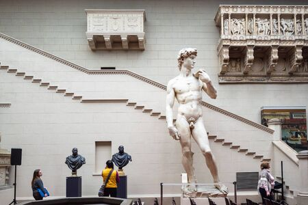 MOSCOW, RUSSIA - JANUARY 25, 2019: visitors near statues in Italian Courtyard of Pushkin State Museum of Fine Arts at Vohonka street. Pushkin Museum is the largest museum of European art in Moscow