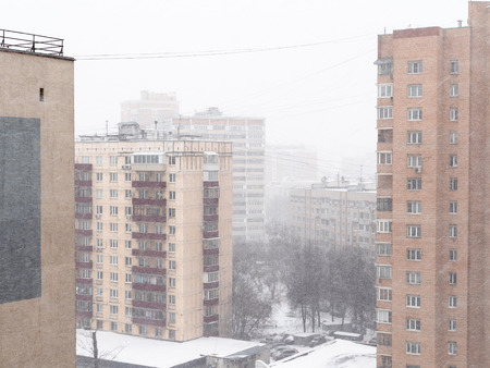 above view of residential quarter in snowfall in Moscow city in snowy winter day