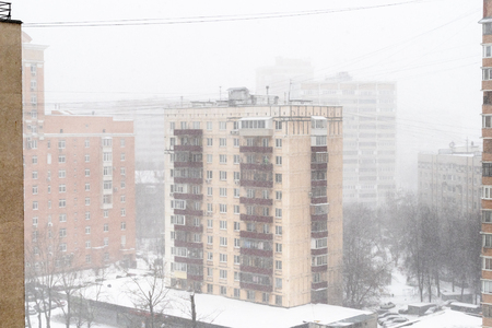 above view of residential apartment houses in snowfall in Moscow city in snowy winter day Stok Fotoğraf