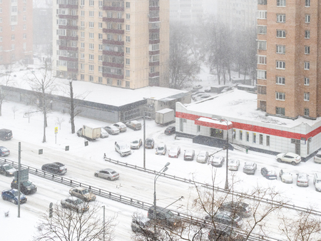 above view of street in residential quarter in snowfall in Moscow city in snowy winter day Stok Fotoğraf