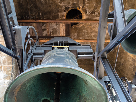 Travel to Italy - bottom view of the bell of Campanone (Torre civica) belltower in Citta Alta (Upper Town) of Bergamo city, Lombardy