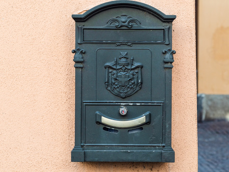 Travel to Italy - old postbox on wall of urban house on street in Lecco city, Lombardy
