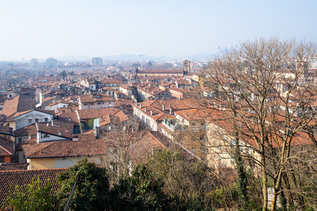 Travel to Italy - skyline of Brescia city with church Santuario di Santa Maria delle Grazie from street Via Militare in spring day