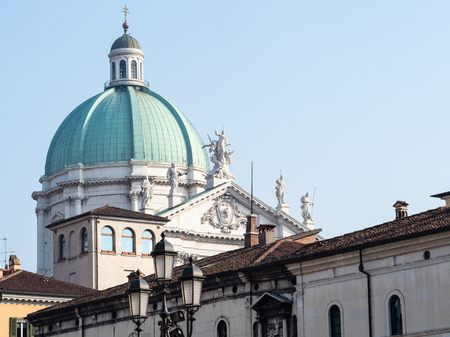 Travel to Italy - view of dome Duomo Nuovo (The New Cathedral) from square Piazza Loggia in Brescia city, Lombardy