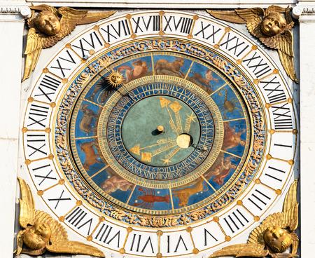 Travel to Italy - medieval street clock on Tower Torre dell'Orologio on Piazza della Loggia in Brescia city.