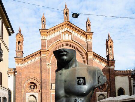 MILAN, ITALY - FEBRUARY 24, 2019: outdoor sculpture Chest in Half by Igor Mitoraj in front of church Chiesa di Santa Maria del Carmine in Brera district of Milan city