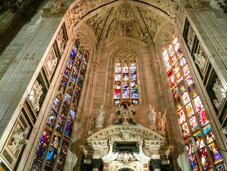 MILAN, ITALY - FEBRUARY 24, 2019: stained glass window over altar in Milan Cathedral (Duomo di Milano) in Milan city. This Basilica is the largest church in Italy Redakční