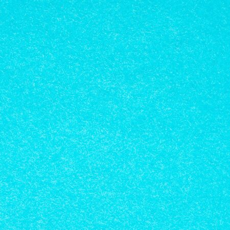square background from blue turquoise velvet flock paper close up
