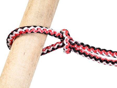 another side of slipped overhand knot tied on synthetic rope cut out on white background