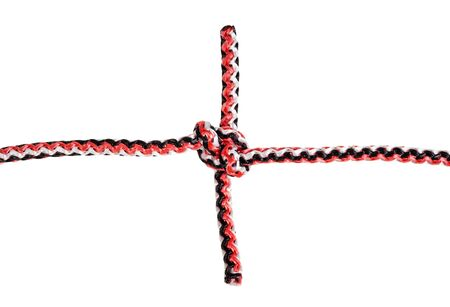 top view of grass knot tied on synthetic rope cut out on white background