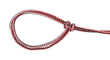 白い背景に切り取られた合成ロープに結ばれた滑った閉じたループの結び目の別の側面 写真素材