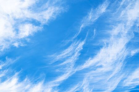 natural background - blue sky with spindrift clouds in the Caucasus in summer afternoon