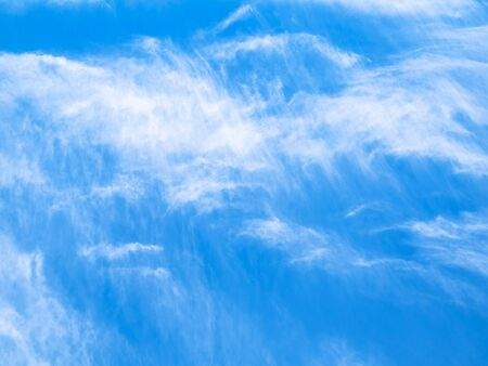 natural background - blue sky with spindrift clouds in the Caucasus in summer day