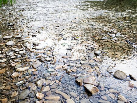 natural background - stone bed of mountain river in the Caucasus (Abin river in Abinsky District in Kuban region of Krasnodar Krai of Russia)