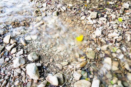 natural background - water flow in watercourse of mountain small river in the Caucasus (Abin river in Abinsky District in Kuban region of Krasnodar Krai of Russia) Imagens