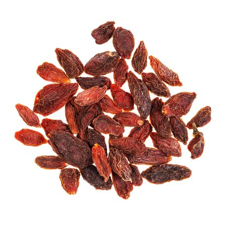top view of handful of dried goji berries cut out on white background