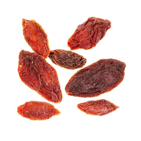 several dried goji berries cut out on white background