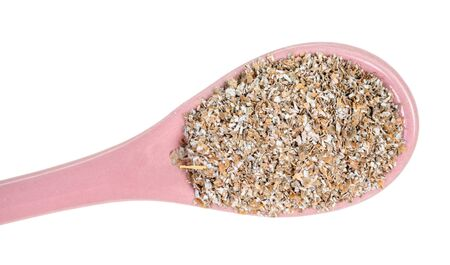 top view of ceramic spoon with rye bran close-up cut out on white background Banco de Imagens