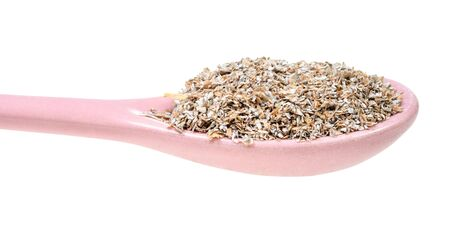 ceramic spoon with rye bran close-up cut out on white background