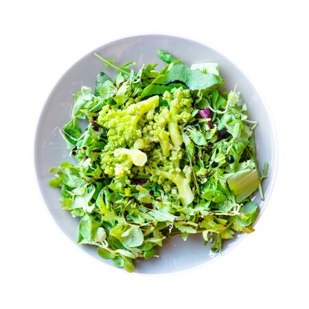 top view of green salad of fresh arugula, mache leaves and boiled Romanesco broccoli with dressing of balsamic vinegar and olive oil Banco de Imagens