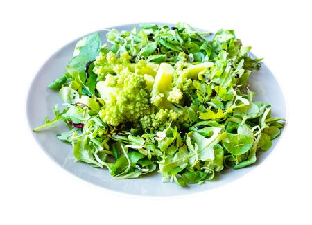 green salad of fresh arugula, mache leaves and boiled Romanesco broccoli with dressing of balsamic vinegar and olive oil