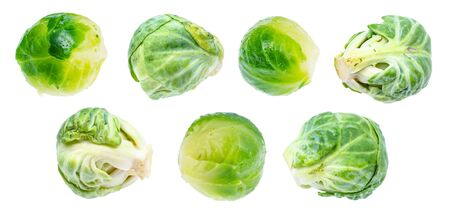 various ripe brussels sprouts cut out on white background