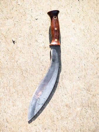 top view of Khukuri traditional Nepali knife on outdoor concrete board 스톡 콘텐츠