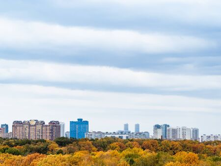 gray and blue clouds in sky over city and yellow park on autumn day 스톡 콘텐츠