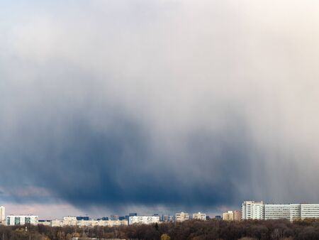 large storm cloud over apartment houses on spring day in Moscow city