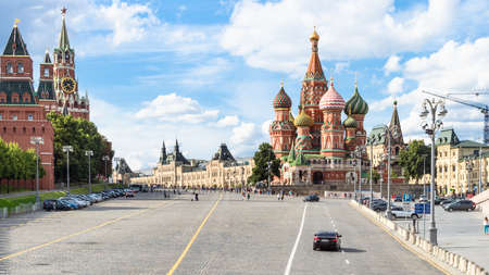 panoramic view of Red Square from Vasilevsky Spusk (Descent) during city sightseeing tour on excursion bus in Moscow city on sunny summer day
