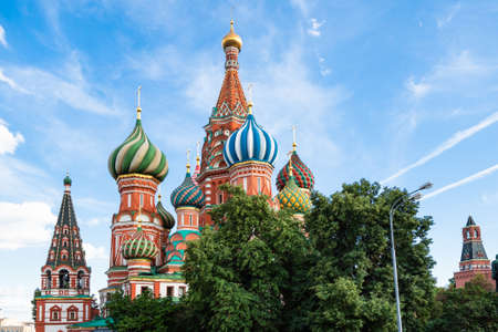 view of Saint Basil (Vasily The Blessed, Pokrovsky) cathedral near Kremlin under blue sky during city sightseeing tour on excursion bus in Moscow city in summer
