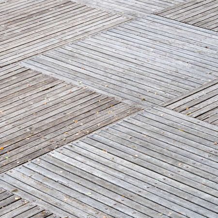 checkered natural bleached wooden pavement of outdoor pier