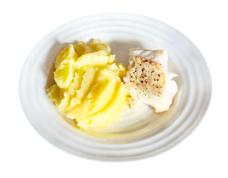 served baked and peppered cod fish with mashed potatoes on white plate cut out on white background 스톡 콘텐츠