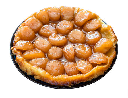 home-made caramelised apple pie Tarte Tatin on plate cut out on white background 스톡 콘텐츠