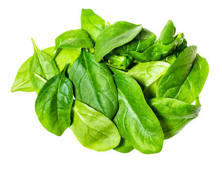 heap of fresh leaves of Spinach leafy vegetable cut out on white background