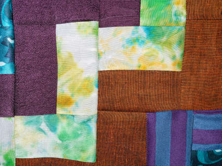 textile background - sewn fragment of patchwork cloth from various fabrics 스톡 콘텐츠