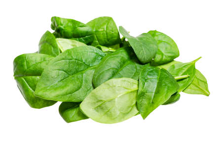 pile of fresh leaves of Spinach leafy vegetable cut out on white background
