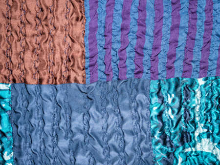 textile background - hand-crafted detail of blue patchwork fabric