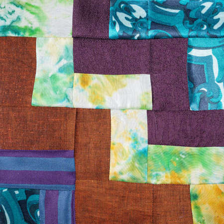 textile background - stitched detail of patchwork cloth from various fabrics 스톡 콘텐츠