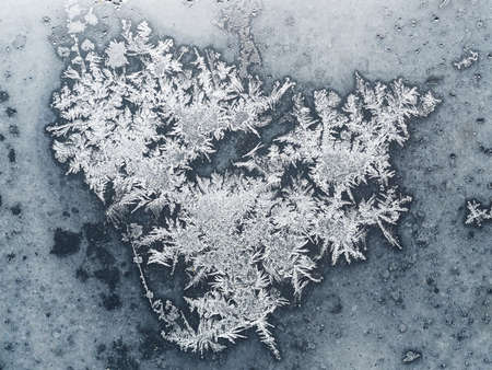 natural background - frozen snowflakes on blue window pane close up on cold winter day Reklamní fotografie